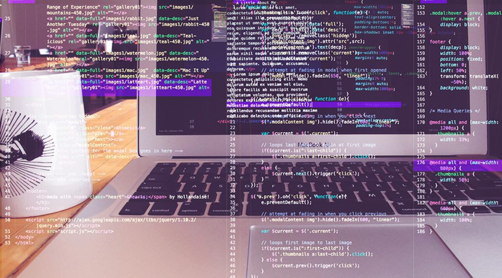 Photo of laptop + coffee mug with code overlaid